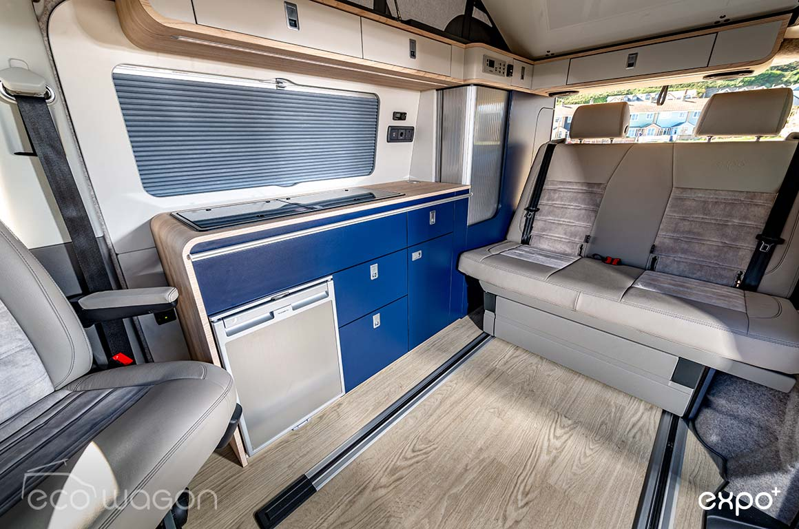 We tried something a little different in this conversion - deep blue units and softer wood and leather accents.